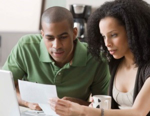 Couple-managing-bills-300x232