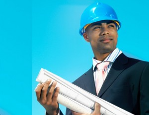 african american engineer in blue hard hat and holding blueprints