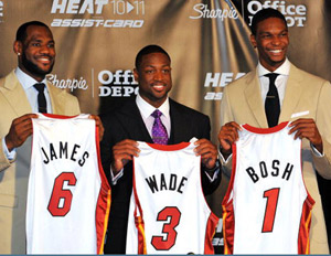 LeBron James, Dwayne Wade, Chris Bosh holding Miami Heat jerseys