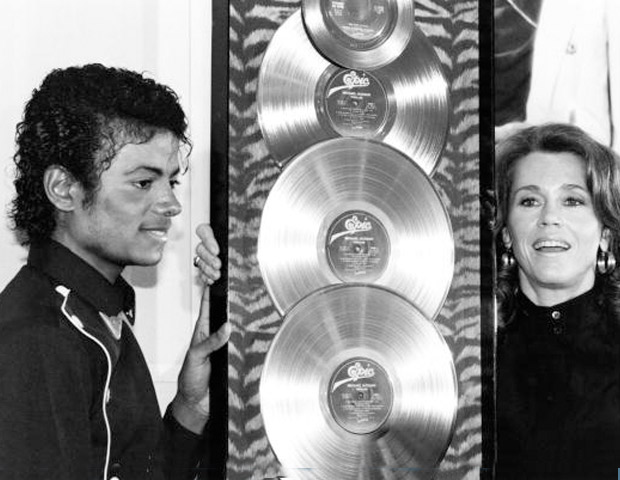 Michael Jackson with platinum plaques