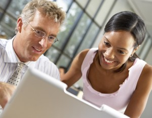 black woman and white man working on computer