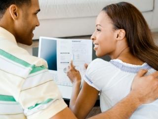 black-couple-paying-bills
