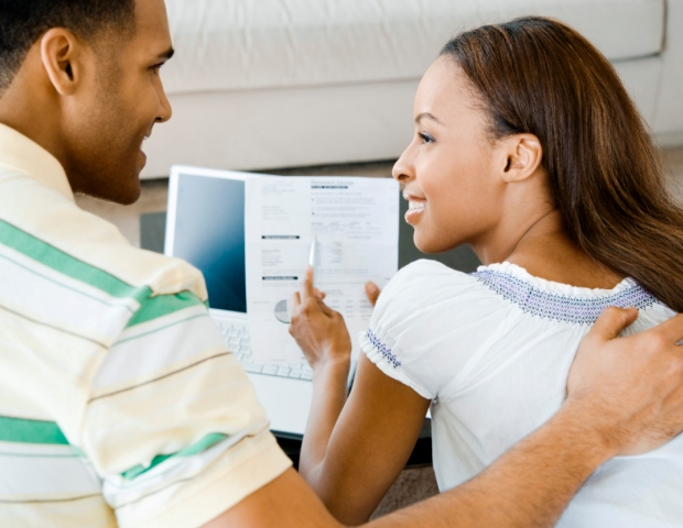 black-couple-paying-bills