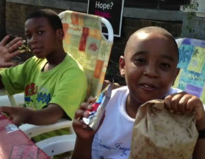 young black children smiling and eating