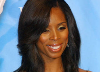 Tasha Smith: Tyler Perry's Muse Puts Work Into Her Marriage (Literally)