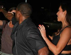 kanye west shoves female paparazzi