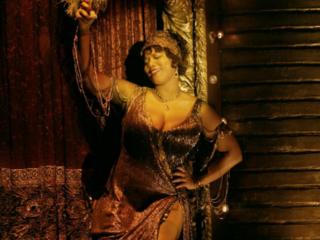 Latifah dances away as Matron Mama Morton in Chicago.