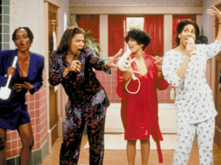Queen rocks out with the cast of Living Single.
