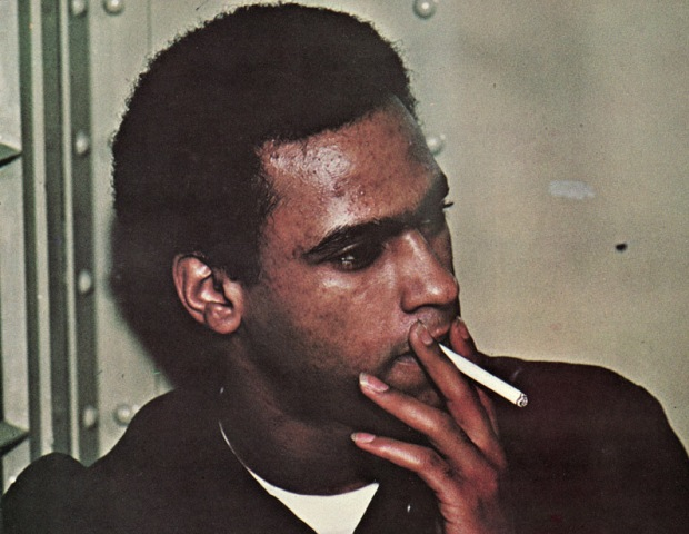 huey p newton smoking a cigarette