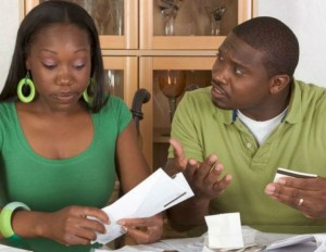 black man and woman arguing over finances