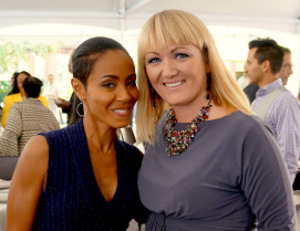Jada Pinkett Smith and white woman smiling