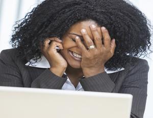 black woman stressed on phone
