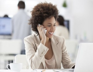 black business woman on phone and computer