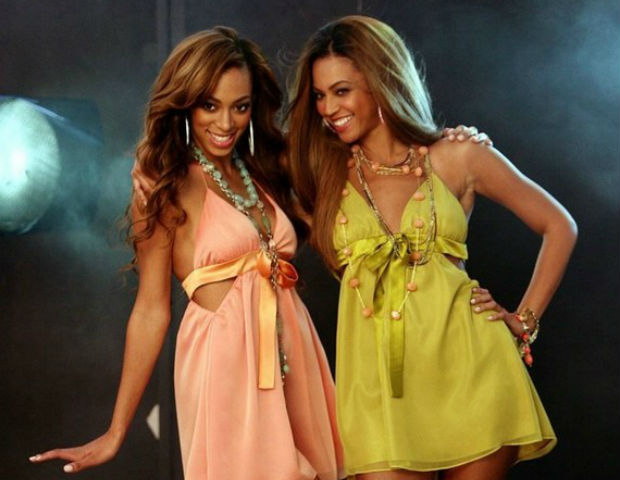 Beyoncé and Solange pose for a sisterly fashion photo.