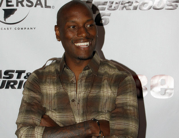 Tyrese smiles for the media
