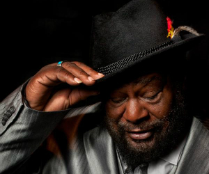 george clinton in suit and hat