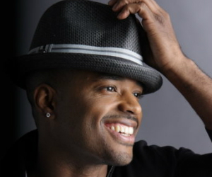larenz tate smiling with a hat on