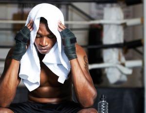 Black man thinking at the gym