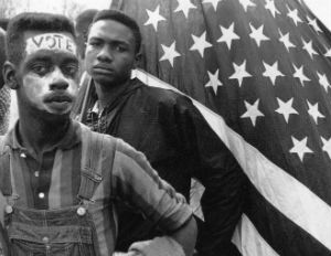 black man marching for voting rights 1960s