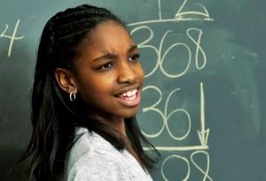 black student at blackboard
