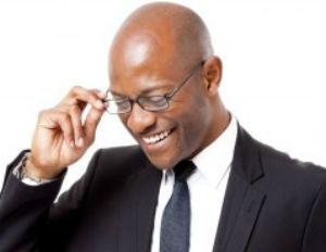 black man suit smiling