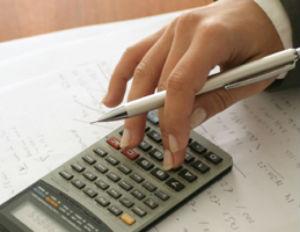 businesswoman on calculator