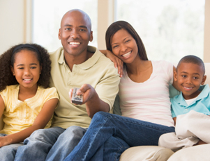 Black family in front of the TV
