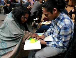 RMathai Praying with Teaching Student