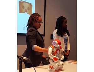 Spelman students displaying their humanoid robot 'spice'