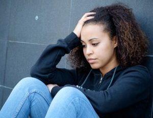 Feel Like a Fake? The Impostor Phenomenon Makes Racial Discrimination Worse