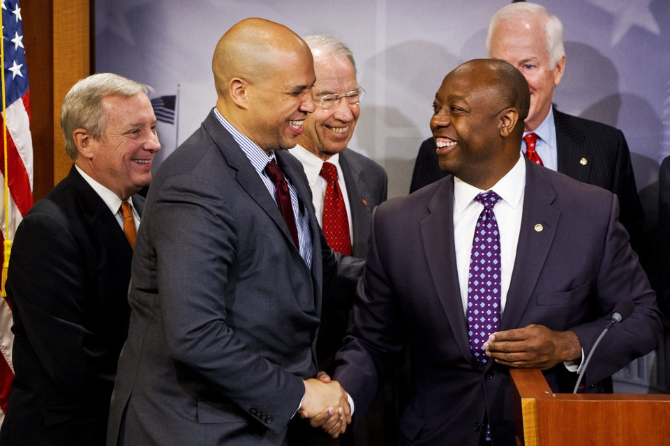 Sen. Tim Scott, R-S.C., right, shakes hands with Sen. Cory Booker, D-N.J., during a news conference on Capitol Hill in Washington, Thursday, Oct. 1, 2015, (AP Photo/Jacquelyn Martin) Investing in Opportunity Act