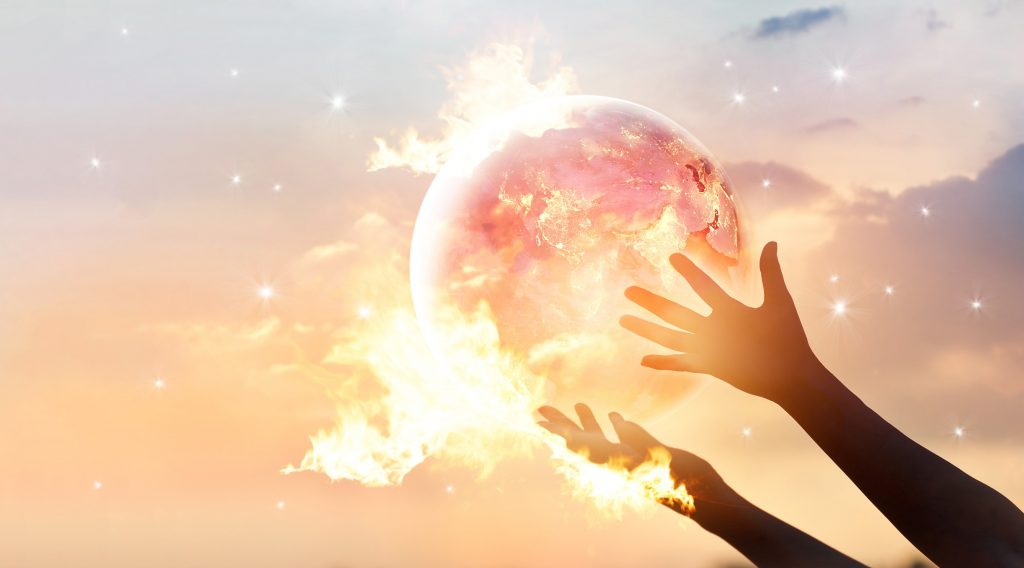 Save the world energy campaign. Planet earth with flame on human hands show energy consumption of humanity at night, Elements of this image furnished by NASA