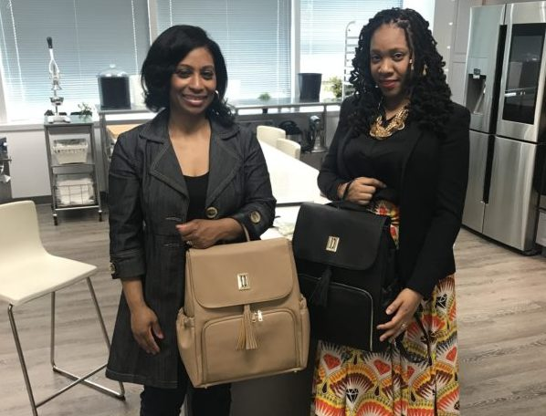 Sherrill Mosee and Tara Darnley with new diaper bag for parents and babies