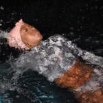 Danielle Obe swimming her Nemes swim cap