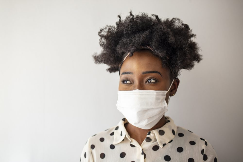 African - American woman wearing mask for protect. - Black Enterprise