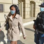 Sarah Anthony escorted after protest