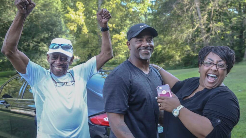 Chester Holman III with his father and sister