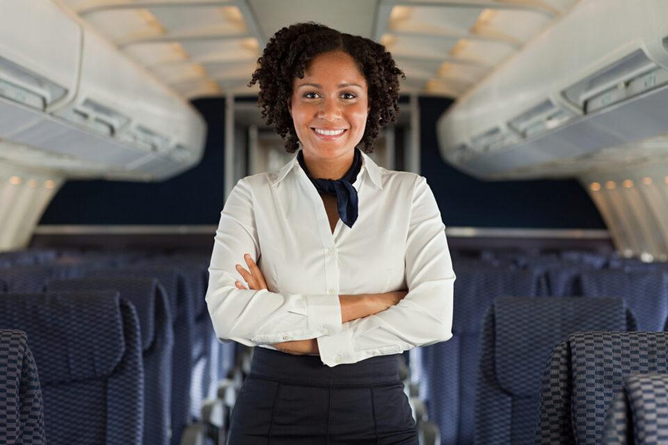 Stewardess on airplane (IStock)